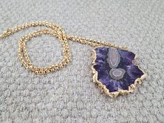 Purple geode slice surrounded by gold fill