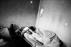 Paolo Pellegrin. AFGHANISTAN. Kabul. May 2006. A heroin addict suffering withdrawal at the Kabul psychiatric hospital.