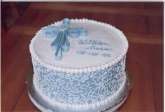 boy baptism - 10 inch cake with bc.  Fondant cross.