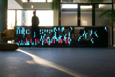 nimma hotel's reception desk is an LED panel displaying real-time news in a modular typeface