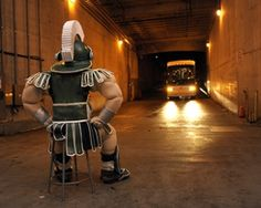 Michigan State Spartans - Sparty waits for the team bus