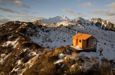 Mt. Brown Hut in the Westland foothills of New Zealand, was constructed by 35 volunteers from the remnants of an earlier alpine hut, with supplies brought in by helicopter.