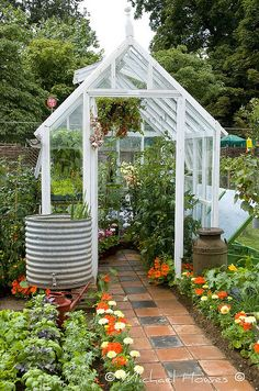 with Flagstones Greenhouse in the backyard.I want the rain barrel with spigot!Greenhouse in the backyard.I want the rain barrel with spigot! Greenhouse Shed, Greenhouse Gardening, Outdoor Greenhouse, Small Greenhouse, Greenhouse Wedding, Greenhouse Growing, Gardening Books, Outdoor Planters, Shed Design
