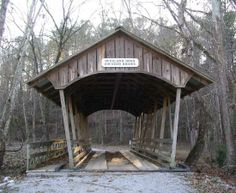 Covered Bridge across Furnace Brook at Brierfield Ironworks Historical State Park in Alabama / by Larry & Donna Wisener