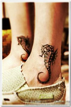 These two friendship tattoos have matching designs and are worn on the same place; the ankle