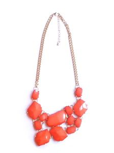 The popular Laura Necklace comes in orange. Wear it to add a little color to your Fall/Winter wardrobe!