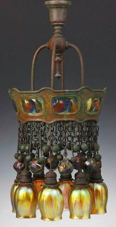 Eight-light bronze and turtleback tile chandelier - Tiffany Studios, circa 1910