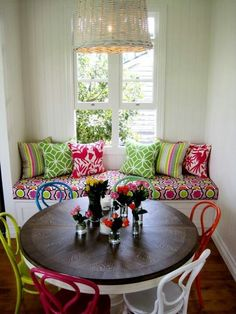 Clarke and Clarke fabric on the bench paired with colorful chairs!