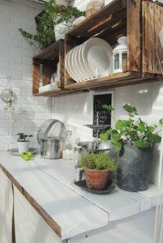 Rustic Kitchen- Attach wooden crates to the wall for rustic looking shelves.