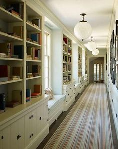 Bookshelves & window seats in a hallway