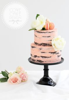 Dark chocolate mud cake with raspberry buttercream in semi-naked style. Decorated with raspberry and rosewater macarons, fresh peonies and roses.