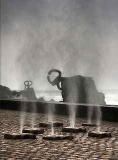 "This is one of the best-known works by the sculptor Eduardo Chillida. The sculpture, known as the ""Peine del Viento"" or ""Wind Comb"", is formed by pinkish granite terraces and three pieces of steel anchored to the rocks.  