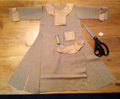Historical handcraft. Trimming an Anglo Saxon or Viking tunic