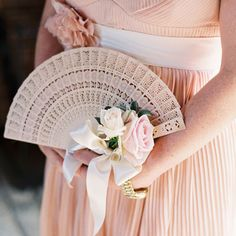 Bridesmaids could carry fans to add to the vintage feel.