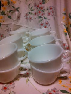 set of 12 matching c handle cups. close up of bottom label says microwave safe Pyrex. This set of c handle cups will go perfectly with any color combination with a white accent to your décor. setting a table for 12 this will cover it for the cups!