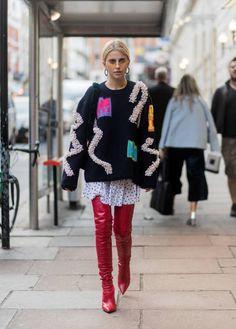 Caroline Daur wearing knit red overknee boots outside Peter Pilotto during London Fashion Week September 2017 on September 17 2017 in London England
