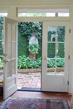I love French doors and plant covered walls/fences. French doors opening onto a courtyard The Doors, Back Doors, Windows And Doors, Wood Doors, Inside Doors, French Windows, French Doors Patio, French Patio, Victorian Patio Doors