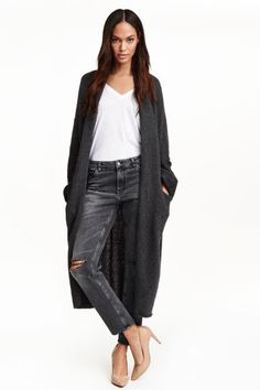 Long cardigan: Long cardigan in a soft knit containing some wool with a shawl collar, dropped shoulders, long sleeves and front pockets.