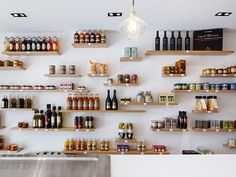 Directly overlooking the Old Port of Marseille, Bertrand Guillon is developing La Sartine, a new place dedicated to delicatessen and catering. The place is a ground floor of a Haussmannian building with a mezzanine, the e … Bakery Design, Restaurant Design, Architecture Design, Tapas, Mezzanine Floor, Contemporary Home Furniture, Oak Shelves, Bottle Shop, Glass Facades