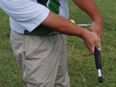 Learn how to properly release your hands through impact for better ball striking using our golf wrist release aid.