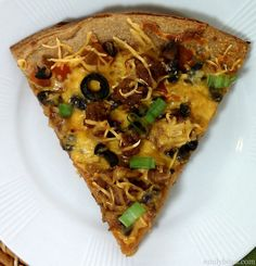 This Mexican Pizza offers juicy tomato salsa, spicy taco sauce, seasoned ground beef, hearty black beans, sharp cheddar cheese, black olives and green onions on a crispy wheat crust. Just 206 calories or 5 Weight Watchers points per slice! www.emilybites.com #healthy