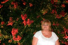 beautiful flowering bush that was even so beautiful at night , I had my picture taken in front of it...picture taken in Gatlinburg Tennesee