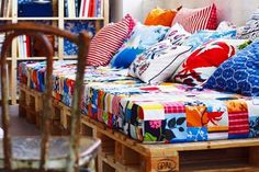 A bed made out of a pallet and cushions!  I really want to do this in my future children's rooms, I think it would make a great mini-couch for friends.
