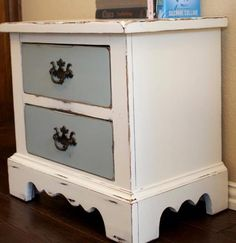 White nightstand with blue drawers