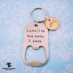 """A fun way to commemorate an anniversary, Father's Day, or special date! This keychain includes a bottle opener that says, """"Love U to the Moon & back"""" with 2 pennies that are hand-stamped with initials, names or a special date"""