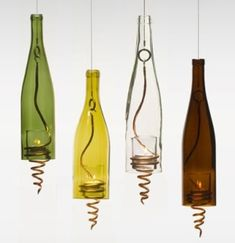 Recycled Wine Bottle Candles. have also seen wind chimes made this way.
