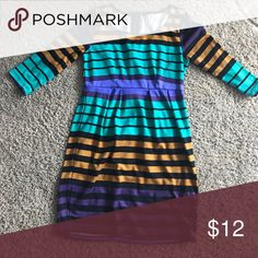 Multicolored striped dress 👗 Multicolored mini dress. In perfect condition with normal signs of wear. Super pretty. 30inches long. Colors are gold, green, purple, and black💛💚💜🖤 Open to offers! Dresses Mini