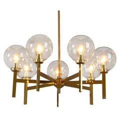 Brass Chandelier with 7 'Globes' by Hans Agne Jakobsson | From a unique collection of antique and modern chandeliers and pendants  at https://www.1stdibs.com/furniture/lighting/chandeliers-pendant-lights/