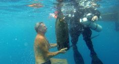 UNDERWATER AGING: Winemaker Pierluigi Lugano, left, checked on a big bottle of wine that a scuba diver brought to the surface in Chiavari, I.
