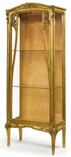 LOUIS MAJORELLE VITRINE giltwood, glass and fabric upholstery 75 3/4  x 31 1/8  x 14 7/8  in. (192.4 x 79.1 x 37.8 cm) circa 1900