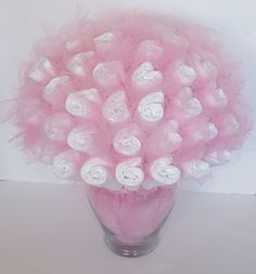 A personal favorite from my Etsy shop https://www.etsy.com/listing/472797999/diaper-bouquet-baby-shower-centerpiece