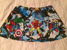 Little girl/toddler skirt featuring Wolverine, Iron Man, Thor, Captain America, and the Incredible Hulk. Made with a 1/2 elastic waistband and