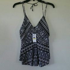 NWT jessica simpson top Brand new with tags, polyester and elastane top. Juniors medium, slight stretch, unique black and white design, snakeskin and stripes. Vneck front, tiered fabric (can kind of tell in pic 2), spaghetti straps plus halter tie. Perfect for night out. Jessica Simpson Tops Tank Tops
