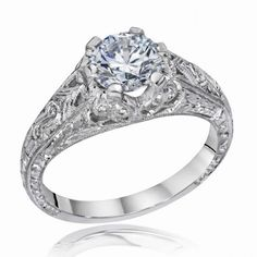 Die-Struck Vintage Filigree (Antique Style) Engagement Ring with a Sweeping Detail. Fine wires are pierced into each side of the mounting. The wires are engraved and milgrained. A fine floral pattern is hand engraved on the shank of the mounting.