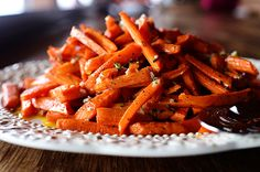 Roasted carrots. Ingredients 1/4 cup Olive Oil 2 Tablespoons Olive Oil 2 Tablespoons White Wine Vinegar 1 Tablespoon Dijon Mustard 1 Tablespoon Minced Garlic 3 sprigs Fresh Thyme, Leaves Removed And Minced 1 sprig Fresh Rosemary, Leaves Removed And Minced 5 pounds Carrots, Trimmed And Peeled  Salt And Pepper, to taste
