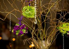 Wedding centerpieces, purple and green with bling!