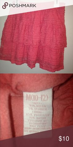 Candies brand tiered lace skirt Candies tiered stretch lace skirt with built in shorts. Color is a melon pink. Size 10/12. EUC. Smoke free home. Candie's Bottoms Skirts