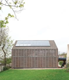PASSIVE PROGRESSIVE Among the first Passive Houses in France, this bamboo-clad farmhouse by the Parisian firm Karawitz Architecture brings a bit of green to tiny Bessancourt. photos by: Nicholas Calcott Bamboo Architecture, Sustainable Architecture, Architecture Details, Residential Architecture, Exterior Wall Cladding, Wood Cladding, Val D'oise, Passive Design, Houses In France