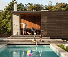 This is not your ordinary pool house. The sliding screens open up to a outdoor dining area and fireplace. Photography by: Simon Devitt Outdoor Seating Areas, Outdoor Rooms, Outdoor Living, Pool House Designs, Swimming Pool Designs, Swimming Pools, Built In Furniture, Outdoor Furniture, House Landscape