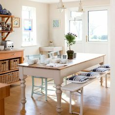Contemporary white dining room, fisherman lights