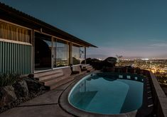 Photographer Tom Blachford is documenting Palm Springs' modernist architecture by moonlight, one year at a time.