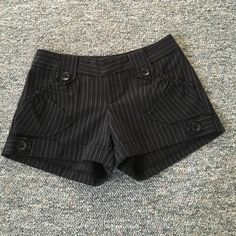 Black and white pinstripe dress shorts Great condition. Black and white pin stripe dress shorts with button accents in front. No pockets in the back. Fleurish Shorts