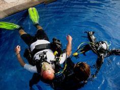 Gili IDC takes her time to teach you rescue exercise 7 at IDC Dive Resort Oceans in Indonesia