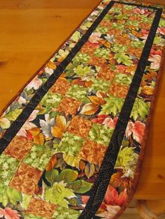Falling leaves table runner.  #afpounce Handmade Table Runner Quilted Leaves | PatchworkMountain - Quilts on ArtFire