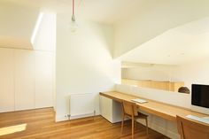 Work bench above the kitchen.    Welsh + Major Architects add to a bungalow in Sydney's heritage suburb of Haberfield.