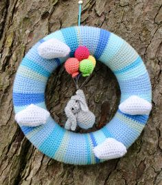 My latest wreath is a first birthday gift for a very special someone. As always the wreath started with lots and lots of stripes of single crochet, this time all in sky blue colours. Having learn… Crochet For Boys, Crochet Home, Crochet Crafts, Crochet Projects, Free Crochet, Baby Boy Wreath, Balloon Wreath, Crochet Wreath, Its A Boy Balloons